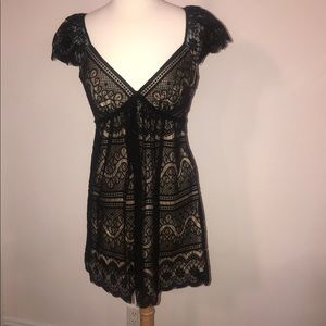 Beautiful lace cocktail dress with silk lining